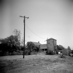 everybody's taking what they can but they can't decide (Super G) Tags: blackandwhite bw house abandoned 120 film farmhouse square telephonepole selfdeveloped holga120n filmforfriday d7695mins68d11