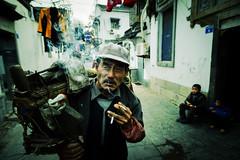 Two Cigarettes (Jonathan Kos-Read) Tags: china delete2 save3 oldman delete3 save7 save8 delete delete4 save save2 smoking save9 save4 save5 choice save10 中国 save6 nanjing 南京 刀 抽烟 knifesharpener 老头 savedbythedeltemeuncensoredgrou
