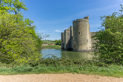 Bodiam Castle (brian_bru) Tags: uk travel summer england sky lake building tree tower castle english history monument water grass stone architecture century rural buildings sussex spring ancient europe exterior place footbridge fort famous great culture scene palace tourist medieval structure east spooky national fantasy trust keep historical british bodiam southeast 14th middle circa moat stronghold surrounding turret built imposing locations destinations postern nobility nonurban