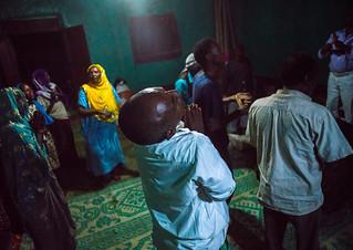 Sufi people go into a trance during a ceremony, Harari region, Harar, Ethiopia