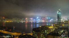 Force Our Way In (Tim van Zundert) Tags: china road city light sea panorama reflection tower water skyline architecture night buildings boats island evening coast construction asia long exposure cityscape crane sony voigtlander towers hong kong shore pollution sha kowloon tsim tsui 21mm ultron a7r
