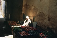 son lux (michel nguie) Tags: africa street light shadow urban man film fruits wall analog dark potatoes onions fez garlic marocco souk medina carrots seated cucumbers crates fes fès médina bunions michelnguie babrcif