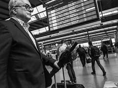 Travel Choices (Streets of Nuremberg) Tags: travel blackandwhite bw monochrome germany munich mnchen bayern deutschland bavaria blackwhite streetphotography business hauptbahnhof schwarzweiss centralstation traveler reisender streetfotografie strasenfotografie geschftsreisender streetsofnuremberg stonurontheroad