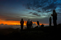silhouette photographer during sunset (sydeen) Tags: camera travel blue light sunset sky orange cloud sunlight mountain man black color nature beautiful silhouette yellow sunrise landscape back photographer view outdoor background tripod picture equipment photograph smoky