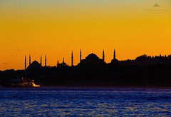 Sunset and Silhouettes (Halil Sopaolu HN I Photography) Tags: blue sunset sea sky sun bird beach water yellow skyline canon landscape photography eos boat photo flickr ship cityscape outdoor dusk weekend silhouettes visit istanbul mosque best follow telephoto vehicle serene 6d 70200mm ayasofya sultanahmetcamii skdar sultanahmetmosque canonllenses salacak greatlandscape likeforlike canoneos6d canon70200mmf28lisiiusm like4like blueistanbul salacakbeach halil2016