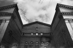 the culture house (Ilona Fogelson) Tags: sky blackandwhite bw building abandoned film architecture analog 35mm canon dark rebel photo russia analogphotography defect artifacts brutal petrozavodsk artefacts canonrebel2000 canoneos300 defects canonef24105 canon24105 svema svema64