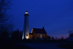 Tawas Point Lighthouse at Night (SimsShots Photography) Tags: lake building brick tower beach architecture outdoor michigan shoreline historic nighttime lakeshore historical beacon huron navigation