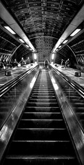 London Underground (Mark.L.Sutherland) Tags: uk england people blackandwhite bw london monochrome lines dark underground mono angle unitedkingdom escalator steps streetphotography cellphone samsung symmetry lookingup smartphone phonecamera sutherland goingup straightlines phoneography androidography galaxys5