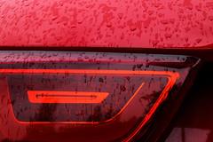 Detail of a car in the rain (katalan46) Tags: red detalle detail texture textura water car rain metal drops lluvia rojo agua led gotas coche su  araba optics optica    damla krmz yamur