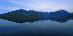 Into the Wide Blue Yonder (charhedman) Tags: blue mountains water clouds reflections vancouverisland kennedylake