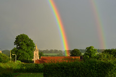 Empingham Village Rainbow (AndyorDij) Tags: rainbow rain raindrops trees hedgerow church stpeterschurchinempingham empingham england rutland uk unitedkingdom gates gatekeeper