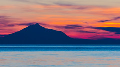 A Colourful Mount Athos Sunset - View from Blue Waves Cafe-Bar - Myrina on Lemnos (Cropped) (Olympus OMD EM5II & mZuiko 40-150mm f2.8 Pro Zoom) (1 of 1) (markdbaynham) Tags: sunset colour clouds island greek view zoom hellas evil olympus mount greece grecia pro gr zuiko omd athos csc oly mz limnos hellenic m43 zd mft lemnos myrina em5 mirrorless micro43 microfourthird micro43rd mzuiko m43rd em5ii zuikolic
