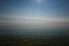 Horizon (Mark Heine Photos) Tags: ca morning sun ontario canada water sunrise rocks solitude horizon georgianbay calm clean clear flare limestone brucepeninsula starburst millerlake dyersbay markheine