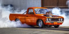 Datsun Drag Racer (Paul Rioux) Tags: auto orange racecar drag automobile nissan outdoor smoke performance victoria racing vehicle modified burnout datsun motorsport autosport westshore westernspeedway prioux