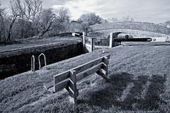 Lock 68 in Black and White (stevedewey2000) Tags: bridge blackandwhite bw monochrome bench landscape canal industrial lock cosina desaturated wiltshire kennetandavon lockgate froxfield vivitar1935 littlebedwyn
