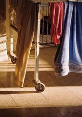 cloth and steel (tal bedrack) Tags: sun color film twilight dry laundry nostalgic cloths warmlight longings kodakultracolor400 prakticamtl3 helios58f2 steelcart