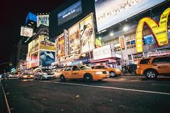 Times Square ( Nino) Tags: street new york city nyc newyorkcity urban horse film night square lights exposure fuji 10 superia manhattan cab taxi grain wide mcdonalds times gothamist mm process 35