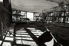 Under the tarp (Spaceball Ricochet (not busy at all...)) Tags: ocean california bw white house black home monochrome architecture digital concrete mono coast construction nikon malibu framing residence residential d80