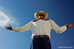 Big Tex holds up the sky (HelenCE) Tags: texas bluesky fair bigtex statefairoftexas sonyrx1 newbigtex vision:mountain=0505