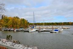100513-120F (kzzzkc) Tags: trees lake canada boats dock nikon day cloudy manitoba autumncolors victoriabeach lakewinnipeg d7000