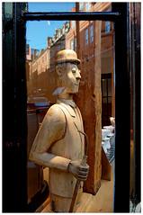 Coffee Shop window (ta_photografik) Tags: wood reflection london window glass coffee shop umbrella wooden figure