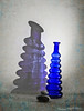 Light and Shadow (derena_d.) Tags: blue light shadow glass silhouette stone canon reflections book memories pebble vase curved wavy leaning textured lean memoriesbook fotocompetitionbronze