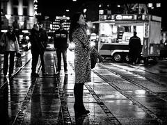 Smoking Woman #1 (Claus Tom) Tags: street blackandwhite bw woman rain weather female night copenhagen denmark evening cigarette candid smoke pipe puff streetphotography cigar hobby smoking nighttime rainy hobbies activity cph climate kbenhavn activities passtime