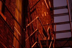 Fire escape # 17 (jimmiesp) Tags: light red abstract building night dark dawn alley nikon downtown day cityscape escape exterior streetlamp bricks 85mm sidewalk fireescape railing saintpaul lowkey streetscenes stpaulmn d5100