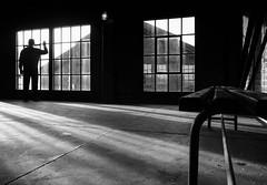 Man at the window (Georgie Pauwels) Tags: life street city shadow urban blackandwhite bw sun man geometric window public lines germany dark women alone shadows view geometry candid citylife olympus passion moment staying dortmund georgiepauwels