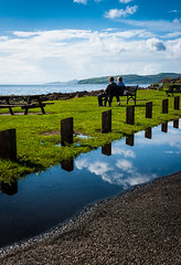 In A Reflective Mood - Colour (DrJekyll UK) Tags: reflection togetherness coast coastal together reflective enjoyingtheview reflectedsky portencross scottishcoast coupleonabench ayrshirecoast