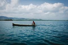 Indigenous Guna in a typical handmade canoe (ROCIO Ysapy) Tags: ocean travel sea landscape turquoise documentary canoe panama yala guna comarca vsco islatigre indigenousguna