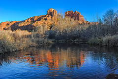 Cathedral Rock reflected in rippled water (TAC.Photography) Tags: arizona sunlight color landscape warm sedona cathedralrock reflectioninwater waterripple