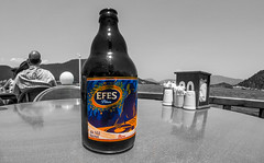 Efes, the Turkish lager. (CWhatPhotos) Tags: cwhatphotos prom promanade people icmeler near marmaris olympus samyang fisheye fish eye 75mm wide angle prime lens water holiday june 2015 photographs photograph pics pictures pic image images foto fotos photography artistic that have which contain digital bythe bikini blue turkey sea beach wear sand walk sky skies clear day hot sunny sun aegeon aegean turkish hols manual focus color colour colours colors select selective partial beer lager brew alcohol efes bottle bottled