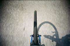 Front wheel. (Markus Moning) Tags: road camera shadow film bike bicycle wheel analog 35mm toy cycling schweiz switzerland tessin ticino fantastic fuji slim superia rad wide fork felt front plastic 200 biking fujifilm expired svizzera viv vivitar ultra schatten velo fahrrad 2012 renner moning rennrad renn rennvelo markusmoning ar4
