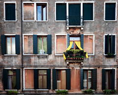 Individuality (bjg_snaps) Tags: venice italy window yellow terrace balcony curtain drape venezia