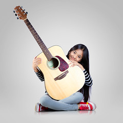 Young guitarist (Patrick Foto ;)) Tags: portrait people musician music white cute classic girl beautiful beauty female youth asian fun happy person grey one kid pretty artist sitting child play ukulele little guitar song background young lifestyle melody musical teen thai sound instrument acoustic string classical leisure practice concept learn guitarist isolated chord unplugged