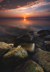 Lake St. Clair Sunstar (Cale Best Photography) Tags: ca morning light orange sun ontario canada nature water sunrise landscape photography dawn spring rocks warm peace calming peaceful calm shore windsor burst essex foreground lakestclair tecumseh sunstar