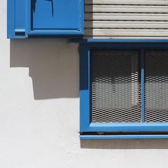 Sitges 2016 (No Great Hurry) Tags: barcelona blue shadow espaa abstract window square 50mm prime spain mediterranean shadows bright catalonia grill shutters minimalism sitges brightness catalua dorada 2016 costadorada costadaurada robinbarr june2016 nogreathurry robinmauricebarr