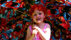 Summer's Cherub (Peter.S.Roberts) Tags: pink light red summer portrait sun art girl beautiful beauty smile face wales painting happy interestingness interesting rainbow artistic cymru creative warmth peaceful content auburn calm sunshade redhead explore parasol serenity stunning impressionism brave summertime freckles welsh colourful charming sunlit relaxed redhair umberella impressionist protected shaded aberfalls swathed peterroberts inexplore abergwyngregyn flickriver nikond7000 fluidr summerscherub