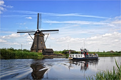 Kinderdijk | 2 (elena_n) Tags: travel vacation sky holland reflection netherlands clouds boat windmills kinderdijk