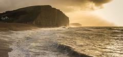 The House on the Hill (scott.hammond34) Tags: sea panorama sunlight seascape storm beach sunrise canon landscape eos coast waves outdoor dorset goldenhour bridport westbay jurrasiccoast stormbarney
