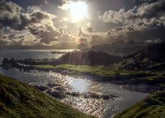 Afternoon Sun (Prosthetic_Head) Tags: sunset sea sun water clouds island coast scotland rocks waves hill cliffs hills oban rays hdr highdynamicrange kerrera