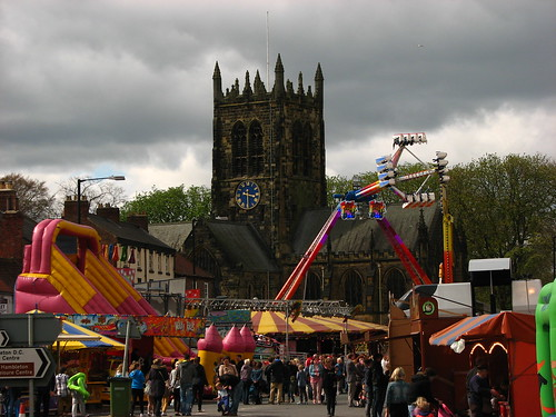 Funfair rides and All Saints church