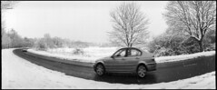 Car in Snowstorm (*monz*) Tags: road street blackandwhite bw panorama snow storm streets tree film kodak iso400 trix 11 panoramic widelux f28 9m 20c xtol f7 26mm monz