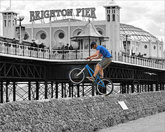 In a world of his own (hehaden) Tags: bike bicycle sussex pier brighton stunt selectivecolor selectivecolour topazadjust topazbweffects