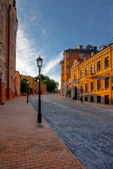 Sunday, 7AM (Matt. Create.) Tags: road street new old city morning blue trees houses windows summer sky urban sunlight brick lamp architecture clouds outdoors daylight early day cityscape view streetlamp ukraine structure kiev kyiv renovated andrewsdescent kyivcity