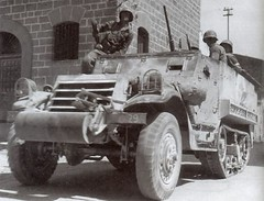 """""""Cochran"""", an M3 Half track of 'C' Company, 82nd Reconnaissance Battalion, 2nd Armored Division in the streets of Ribera, Sicily on 25th July 1943. Doing security patrol."""