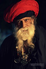 A disciple in Mian Mir shrine, Lahore (Mobeen_Ansari) Tags: pakistan light red portrait night beard 50mm lowlight shrine pirates low carribean traveller turban punjab lahore mir disciple mazar mian darbar mazaar nikond7000