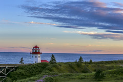 Atlantic Lighthouse Sunset (vamp8888) Tags: ocean flowers sunset summer lighthouse canada clouds canon landscape photography eos photo skies colours horizon august atlantic qubec gaspesie 6d granderivire