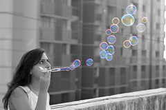 Blowing Bubbles (Anshul Roy) Tags: people blackandwhite bw monochrome rainbow nikon prism bubbles humans blowingbubbles nikond3200 selectivecoloring peoplephotography d3200 humanphotography bubblephotography